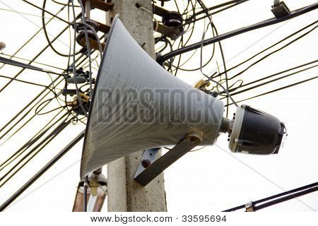 Horn speakers on poles.