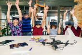 Korean Scientist With The Group Of Young Pupils With Laptop And Vr Headsets During A Computer Scienc poster