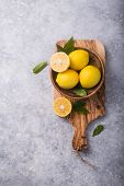 Fresh Lemons And Leaves On Grey Stone  Background. Fresh Fruits And  Slice Flat Lay. Citrus Backgrou poster