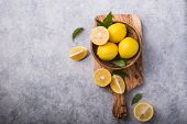 Lemons. Yellow Lemons. Fresh Lemons. Fresh Lemons And Leaves On Grey Stone  Background. Fresh Fruits poster