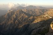 stock photo of jabal  - Mountain landscape of the Sayq plateau in the morning light Jebel Akhdar mountains Sultanate of Oman - JPG