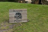 image of landmines  - wooden warning shield beware of mines in german language  - JPG