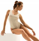 Photo Of Ballet Dancer Gracefully Sitting On Cube poster