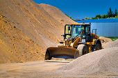 The Tractor Collects A Scoop With Gravel. Excavator Extracts Sand And Gravel For The Concrete Mix. B poster