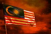 Fluttering Malaysia Flag On Crimson Red Sky With Smoke Pillars Background. Malaysia Problems Concept poster