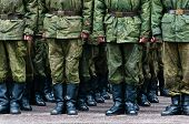 picture of wet pants  - Soldiers in camouflage stand in formation legs only view - JPG