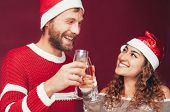 Happy Couple Celebrating Christmas Holidays - Young People Having Fun Drinking Champagne And Laughin poster