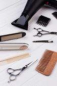 Hairdresser Tools On Wooden Background. Set Of Hairdresser Tools And Accessories. poster