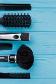 Hairdressing Equipment On Color Background. Set Of Hairdresser Tools On Blue Wood. Space For Text. poster