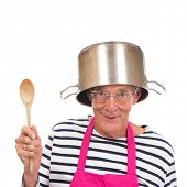 Senior houseman with pink apron and cooking pot isolated over white background poster