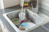 Unwashed Dishes And Utensils In A Kitchen Sink. Pile Of Dirty Dishes In A Sink. Washing Dishes Conce poster