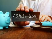 Hand Is Hilding 401k Or 403b Plan Sign. Choosing Retirement Plan Concept. poster