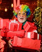 Shopping Christmas Gift. Party Man In Colorful Wig. Presents From Santa. Happy New Year. Secret Sant poster