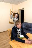 Domestic Violence: Wife Trying To Beat Her Husband With A Chair poster