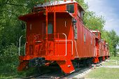 picture of caboose  - Red Caboose Wagon on Tracks with Trees - JPG