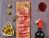 Traditional Spanish Tapas, Snacks Slices Of Serrano Ham, Fresh Chopped Jamon Olives On A Wooden Boar poster