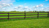 Green Fence Field And A Blue Sky. Pastures Out Of Town. poster