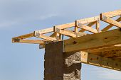 pic of rafters  - Manufactured truss rafters are used on this new construction site - JPG