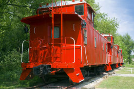 foto of caboose  - Red Caboose Wagon on Tracks with Trees - JPG