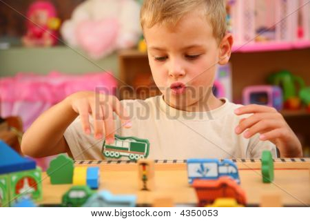 Boy Plays  In Playroom