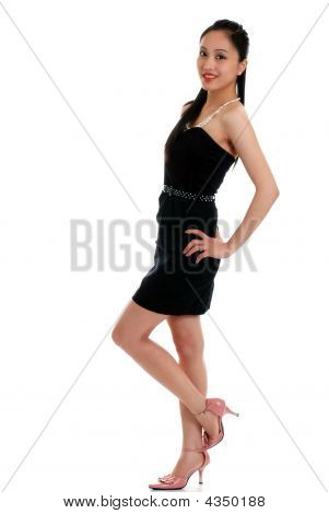Happy Asian Woman Wearing A Black Dress Isolated