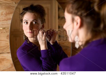 Woman In Front Of A Mirror.