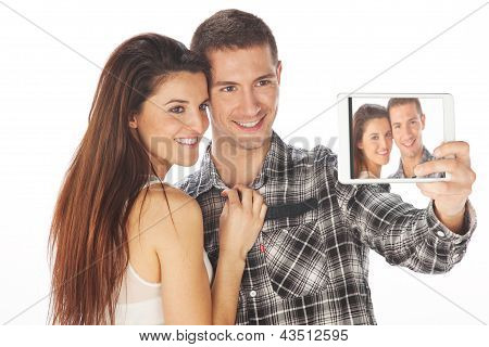 Happy Couple Makes Self-photo On The Notebook