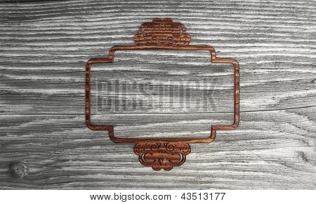 Flourish curlicue label symbol  in a wooden background