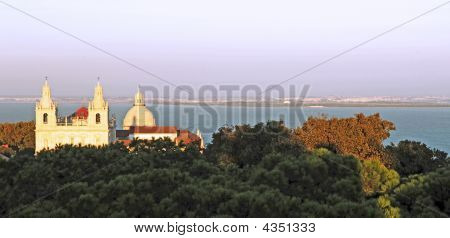Portugal, Lisbon: Church And Taje River At Dusk