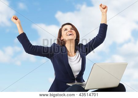 Young Businesswoman Celebrating A Success Working With Laptop