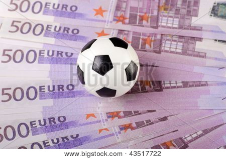 Soccer ball on background of euro