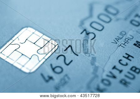 Details of a credit card with chip and numbers.