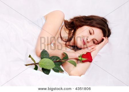 Sleeping Girl In Bed With Rose