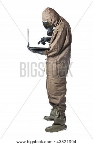 Man In Hazard Suit Using A Laptop