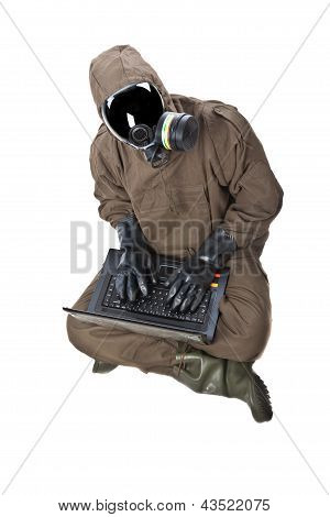 Man In Hazard Suit With Laptop