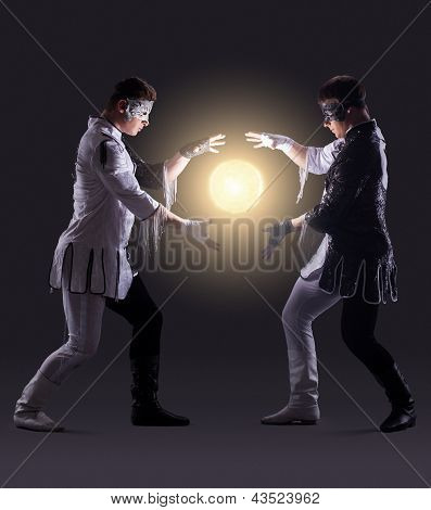 Two magicians creating fireball