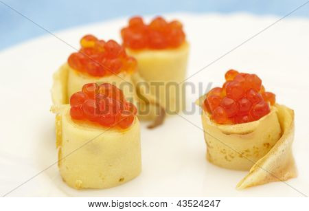 Pancake roll with red caviar