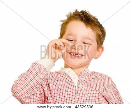 Child checking out his lost tooth isolated on white