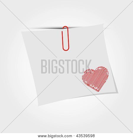 White paper note with clip and red heart