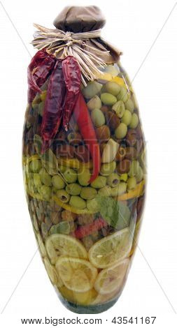Jar of olives and vegetables as preservatives.