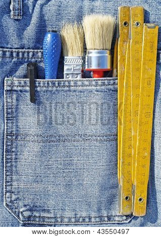 Tools in a blue jean pocket