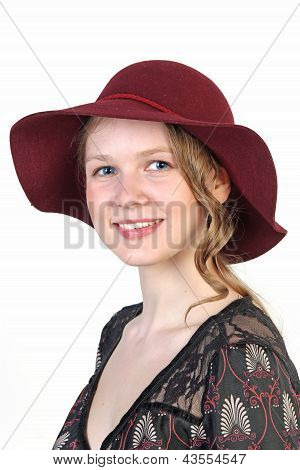 Portrait Of  Young Blonde Woman In  In Red Hat