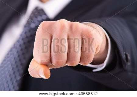 Business man showing punch.