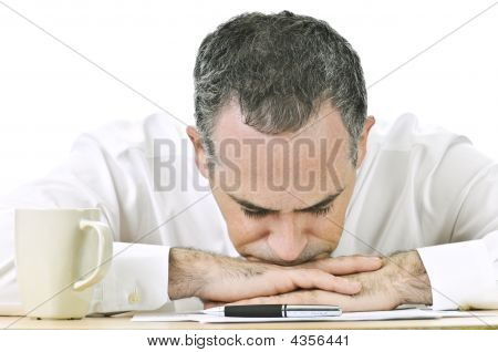 Businessman Resting Head On Hands