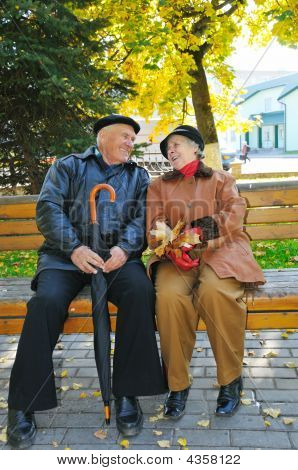 Happy Grandparent On Bench