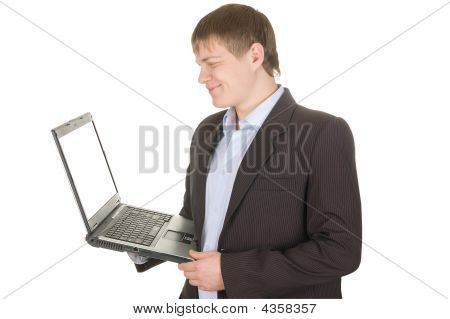 Smiling Businessman Holding A Laptop With White Screen.