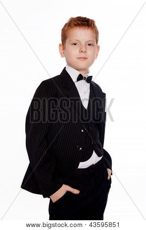 Boy with red hair in a black suit