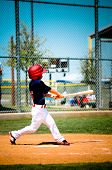 stock photo of little-league  - Little league baseball player swinging the bat - JPG