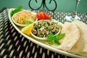 stock photo of tabouleh  - Tabouleh with hommus and lemon chick peas with fresh pita bread - JPG