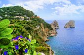 stock photo of off-shore  - Famous Faraglioni rocks off the island of Capri - JPG